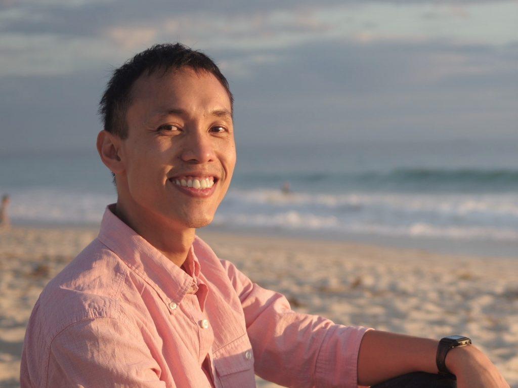 Law Yao Hua smiling.