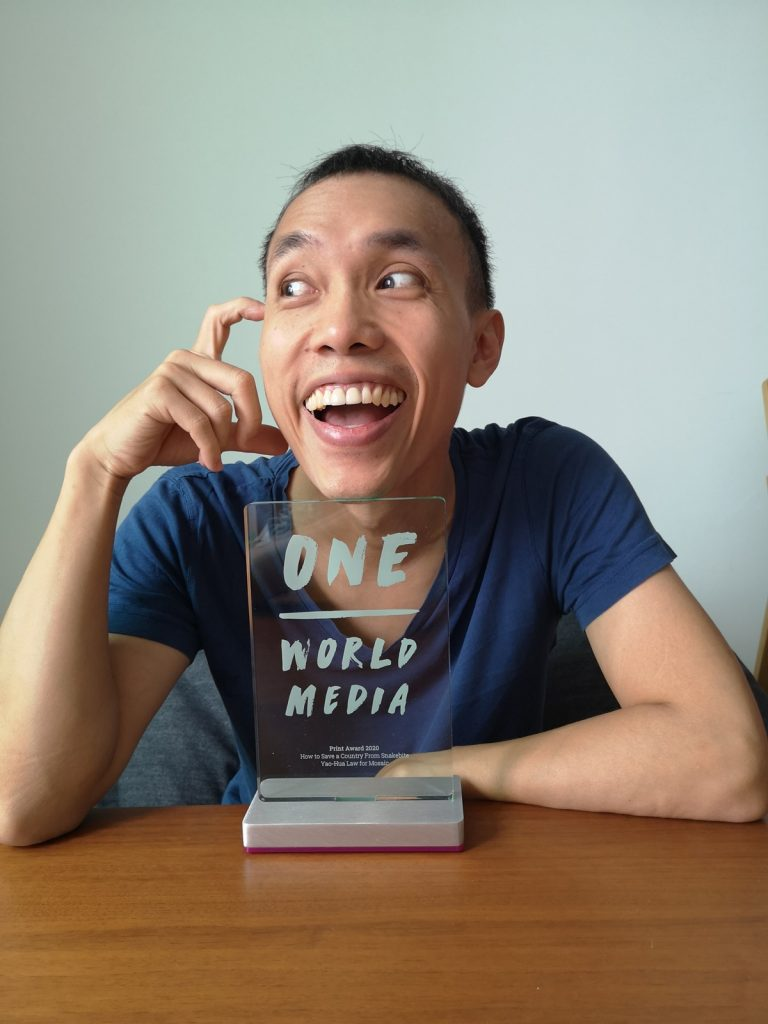 Law Yao Hua smiling with One World Media Award trophy 2020.